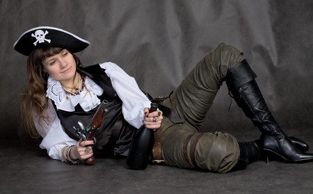 Drunken girl - pirate on black with pistol and bottle photo