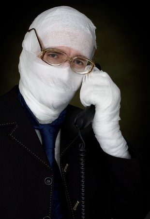Man in bandage with eyeglasses  calling on phone Stock Photo - 4403613