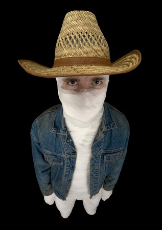 staunch: Portrait of totally bandaged cowboy with a hat on