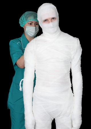 Man in bandage and nurse on black background Stock Photo - 4403546
