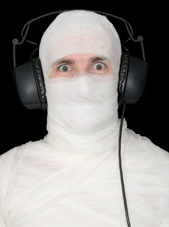 anonymity: Man in bandage with ear-phones on black