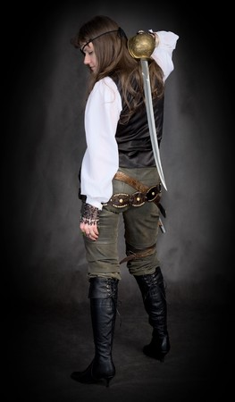 sabre: The girl - pirate with a sabre in hands and eye patch on face Stock Photo