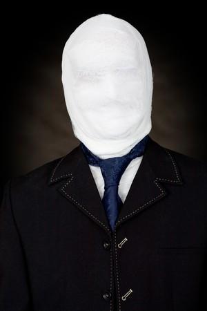 mummified: Man in bandage and the cravat on black