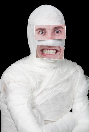 Bandaged man with false paper face on black Stock Photo - 4403758
