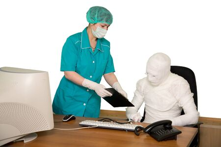 mummified: The bandaged businessman and nurse in office