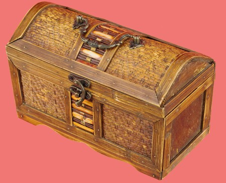 bronzy: Wooden chest with iron handles on the red background