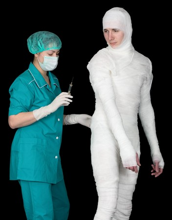 Doctor to give an injection on bandaged patient photo
