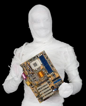 bandaged: Bandaged man with motherboard on black background