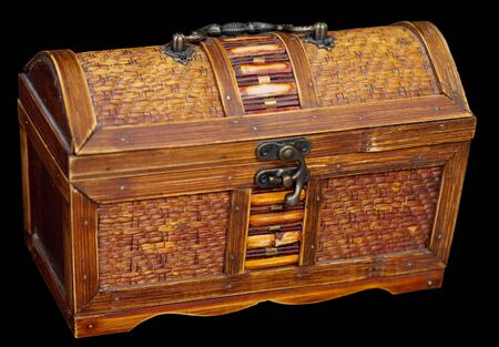 bronzy: Wooden ancient chest on the black background
