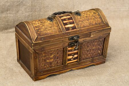 bronzy: Wooden chest with iron handles on the sacking background Stock Photo
