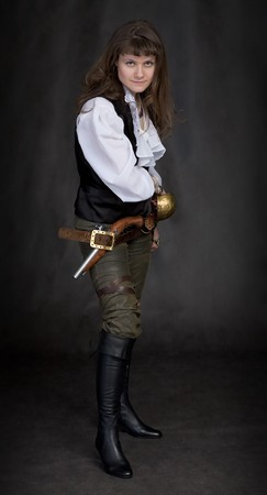 sabre: The girl - pirate with a sabre in hands on a black background Stock Photo