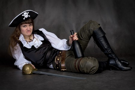 Girl - pirate on black with rapier and bottle photo