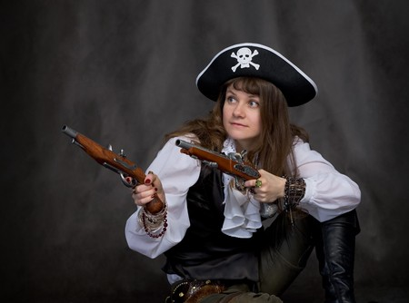 Girl - pirate on black with two pistols in hands Stock Photo - 4472489
