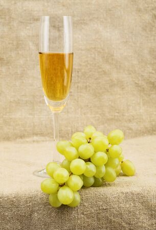 stilllife: Still-life with a glass of wine and grapes on sacking background Stock Photo