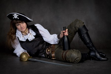 rapier: Girl - pirate on black with rapier and bottle Stock Photo