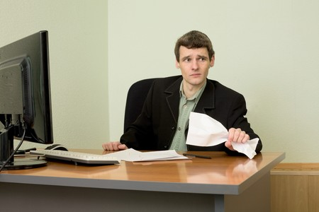emotionality: The director on a workplace with a crushed paper in a hand Stock Photo