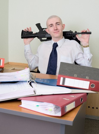 The self-satisfied worker of office armed with a rifle photo