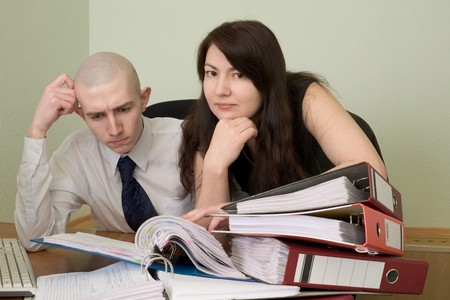 The bookkeeper and the secretary on a workplace at office photo