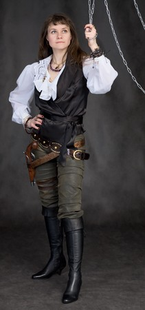 The girl - pirate and metal chain on black background photo