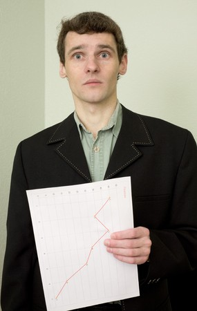 emotionality: Director on a workplace with a graph in a hand Stock Photo