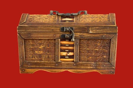bronzy: Ancient wooden chest on the red background Stock Photo
