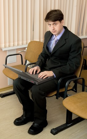 The person in a suit with the laptop in a lap Stock Photo - 4525223