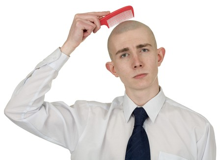 Absolutely bald guy with a hairbrush in a hand