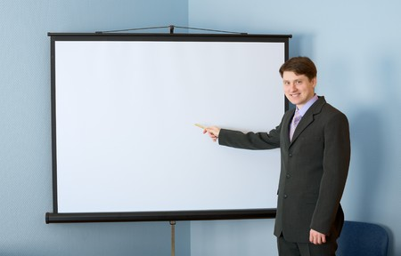 deliberation: The businessman standing near the white screen