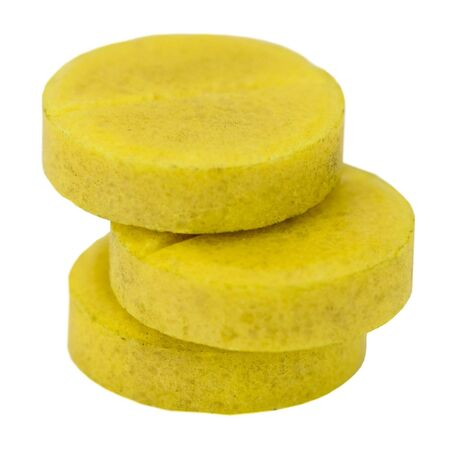dope: Three yellow tablet on the white background