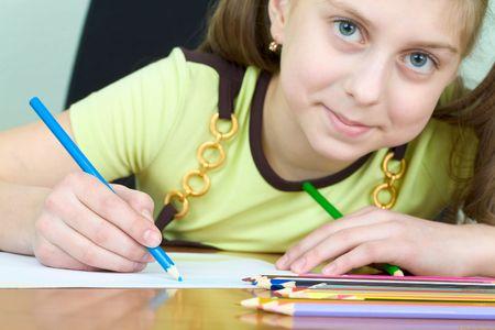 Girl holding a color dark blue pencil photo