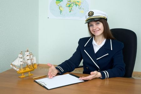 itinerary: The woman in a sea uniform at table with tablet Stock Photo