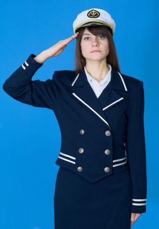 salutes: The girl in a sea uniform salutes Stock Photo