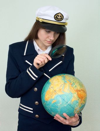 itinerary: The girl in a sea uniform with the globe in hands