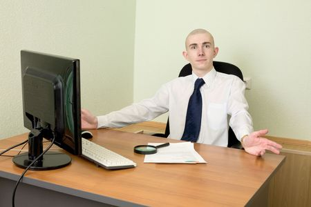 Manager in white shirt on a workplace photo