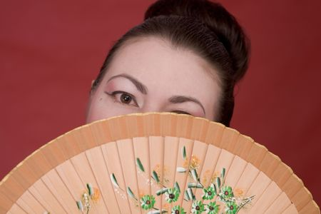 Portrait japanese girl with fan on the red photo
