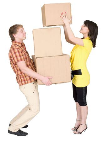 loads: Girl loads the young man with cardboard boxes