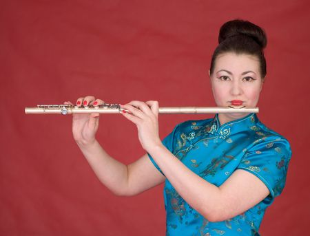 Japanese girl with flute on the red background photo