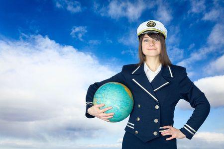 terrestrial globe: Girl in sea uniform and terrestrial globe Stock Photo