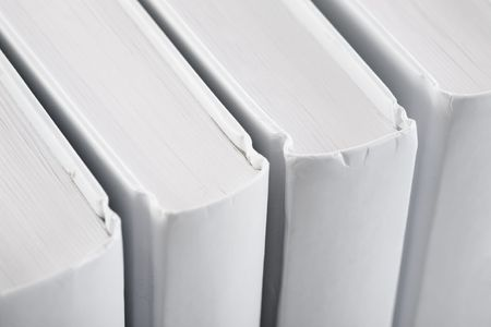 White backs of books photographed close up