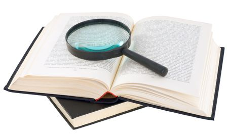 Open book and magnifier on a white background photo