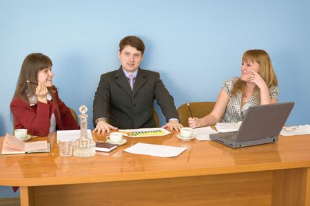 deliberation: Business team sits at the big table