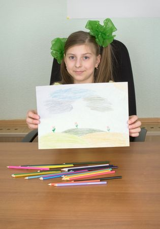 The smiling girl shows new drawing to us photo