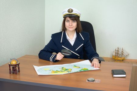 Girl in the form of the sea captain at office photo