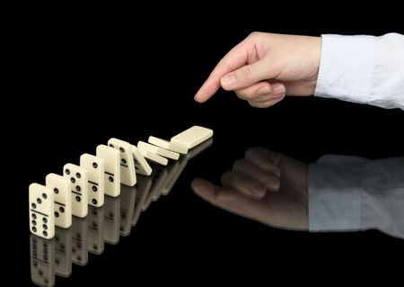 wavering: Domino effect in operation on a black background