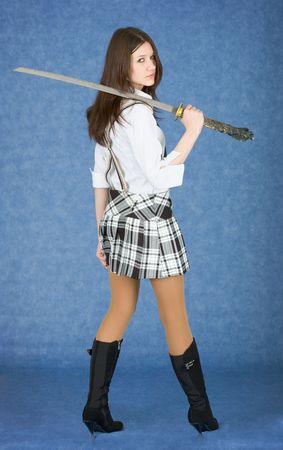 suspenders: Beautiful girl on blue background with  sword on a shoulder