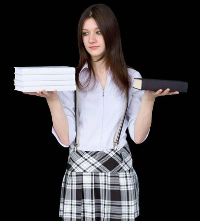 Girl with books on hands on a black background photo