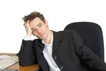 Sorrowful businessman at the office, on a workplace photo