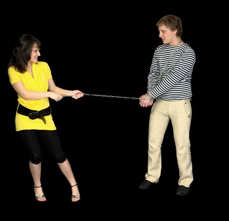 conducts: Young beautiful girl conducts on a chain of the guy