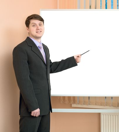 Office workers discuss work standing at a board photo