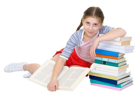 blinkers: Girl sits having leant the elbows on a pile of books